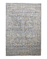 Made In Egypt Distressed Floral Area Rug