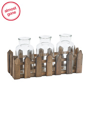3 Bottles In Fenced Crate